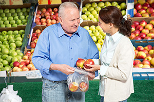 Woman and man shopping for fruit